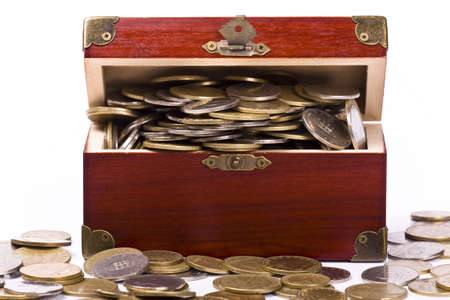 Wooden chest with coins inside isolated Stock Photo - 4969952
