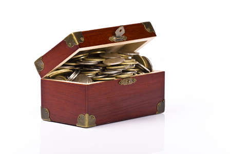 Wooden chest with coins inside isolated Stock Photo - 4969852