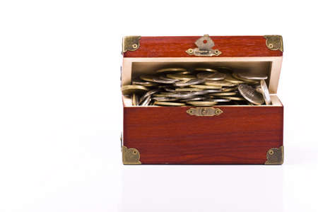 Wooden chest with coins inside isolated Stock Photo - 4969821