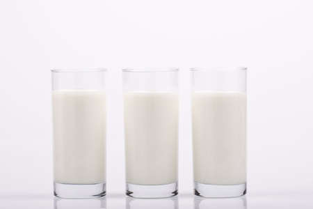 cow teeth: glass of milk Stock Photo