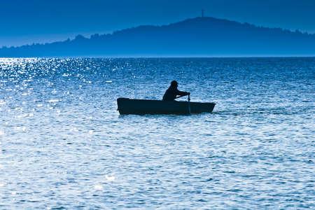 pescador: Silueta del pescador Foto de archivo
