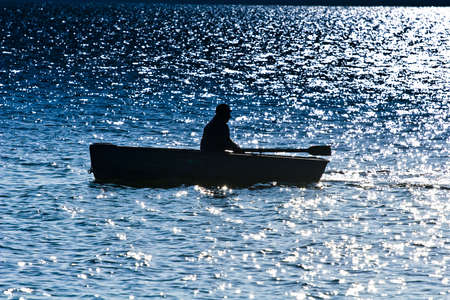 Silhouette of the fisherman Stock Photo - 5320470