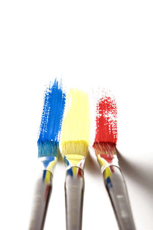 rnart: paintbrush painting a rainbow stripe  Stock Photo