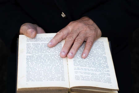 old hands and bible photo