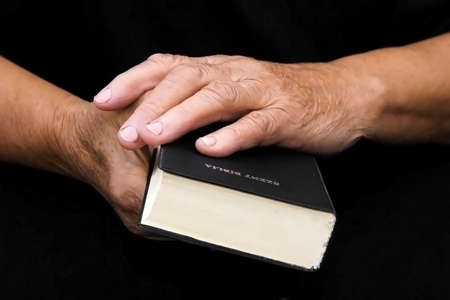 hands and bible photo