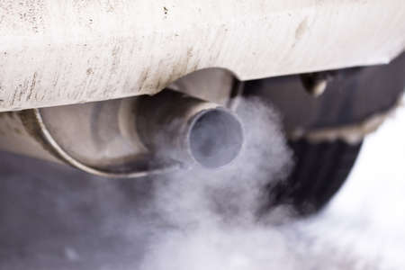 carbon pollution: Smoke exhaust pipe car  Stock Photo
