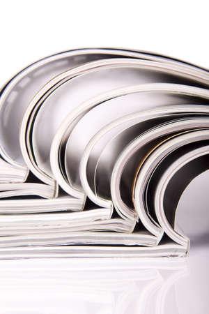 Magazines over white  photo