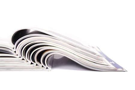 Magazines over white