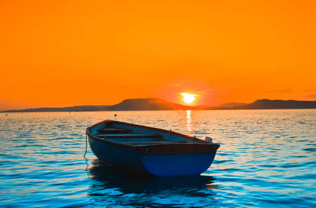 A beautiful Sunset seen the fishing boat photo