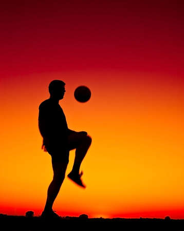 athletic symbol: football at sunset Stock Photo
