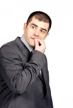 Worried businessman against white background Stock Photo - 7110775