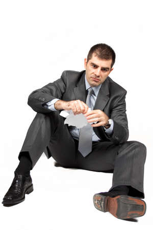 Worried businessman against white background  Stock Photo - 7110673