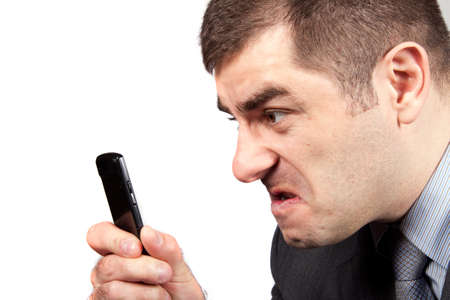 stressed businessman screaming in telephone photo