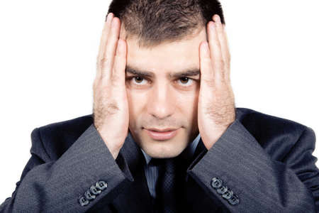 Worried businessman against white background Stock Photo - 7110867