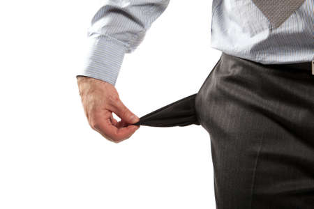 Disappointed businessman with empty pockets isolated over white  photo