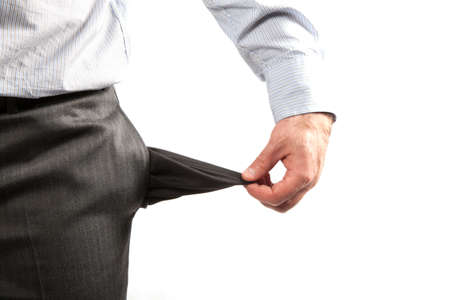 Disappointed businessman with empty pockets isolated over white  Stock Photo - 7110679