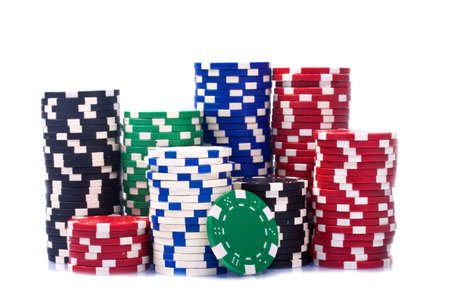 gamblers: Stacks of poker chips  on a white background  Stock Photo