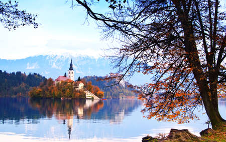Bled with lake, island, castle and mountains in background, Slovenia, Europe photo