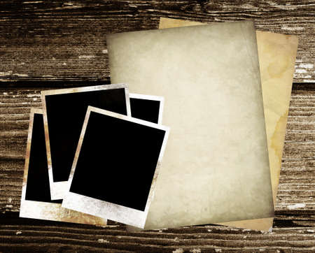 vintage paper and photo on wood background  photo