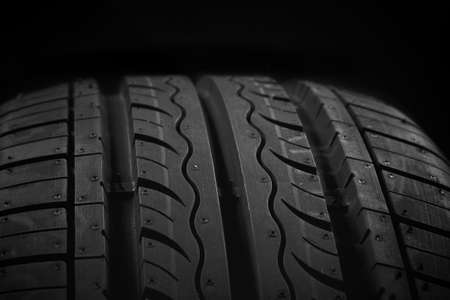 Car tire on black background photo
