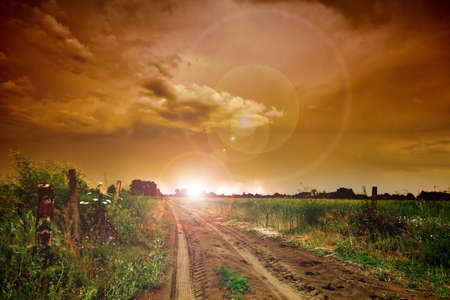 Rural road and dark storm clouds Stock Photo - 9811049