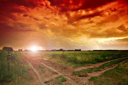 Rural road and dark storm clouds Stock Photo - 9811051