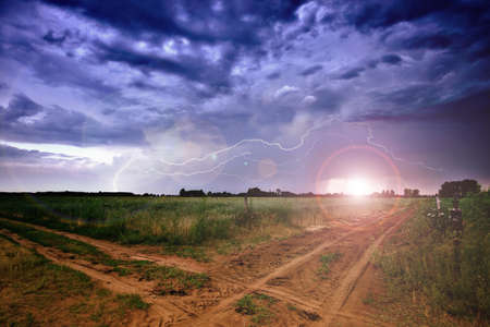 Rural road and dark storm clouds Stock Photo - 9811048