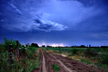 Rural road and dark storm clouds Stock Photo - 9811047