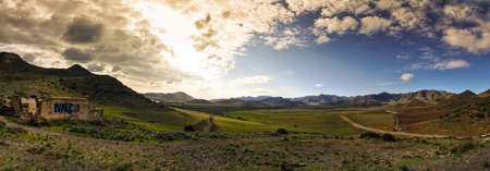 Spanish landscape. Desolate rural area in mountains of Andalusia. Agave plants. Cabo de Gata natural park near Almeria.  photo