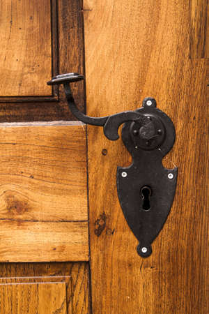 an old wood door with metal handle  photo