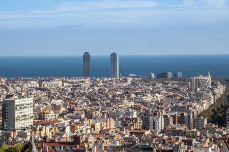 Panorama of Barcelona cityscape with Sagrada Familia in foreground and sea in background. Barcelona, Catalonia, Spain, Europe.  photo
