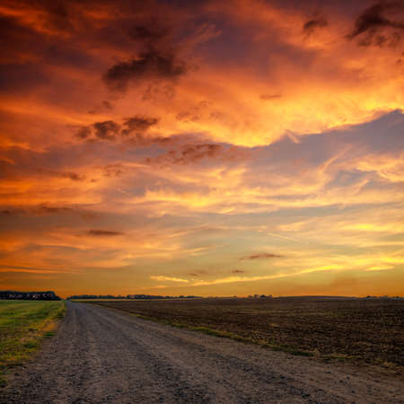 Road in meadows and beautiful sunset.this photo made by HDR technic photo