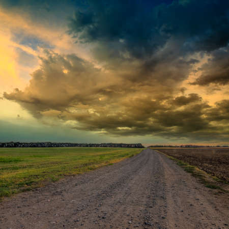 Road in meadows and and dramatic sky.This photo made by HDR technic photo