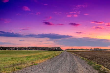 Road in meadows and beautiful sunset.this photo made by HDR technic Stock Photo