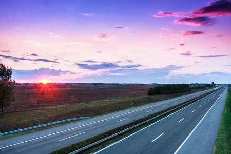 Cars speeding on a highway, Hungary photo