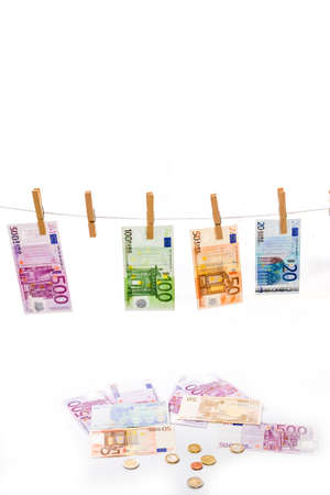 money laundering: Euro money laundering on clothesline isolated on white background