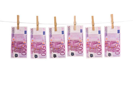 Euro money laundering on clothesline isolated on white background photo