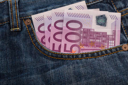 Euro banknotes in jeans back pocket photo