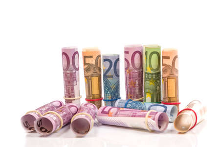 Rolled up Euro bills isoltaed background photo