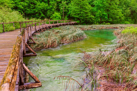 Wooden tourist path in Plitvice lakes national park photo