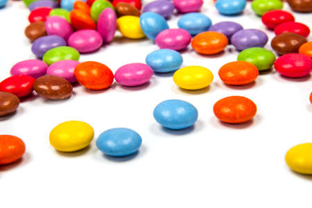 Close up of a pile of colorful chocolate coated candy photo