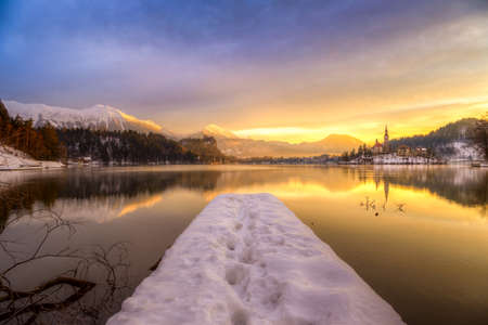 Amazing sunrise at the lake Bled in winter, Slovenia, Europe photo