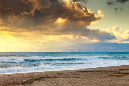 Sunset beach in natural park the  Gabo de Gata, Almeria, Spain photo