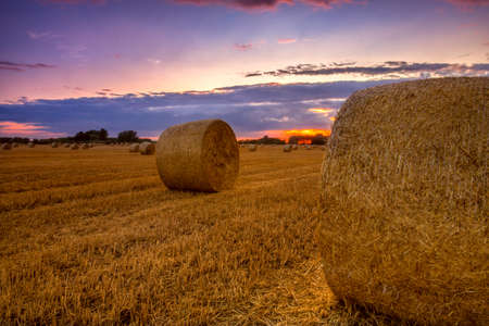 End of day over field with hay bale in Hungary. This photo make in HDR technic photo