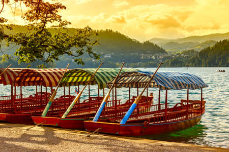 Traditional wooden boats Pletna on lake Bled, Slovenia-Europe photo