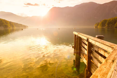 Sunset on the lake Bohinj in Triglav national park, located in the Bohinj Valley of the Julian Alps. photo
