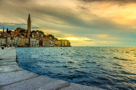 Rainy sunset  in Rovinj old town in Adriatic  sea coast of Croatia, Europe photo