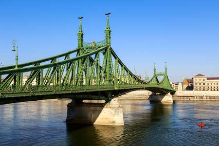 Liberty Bridge over Danube river in Budapest, Hungary photo