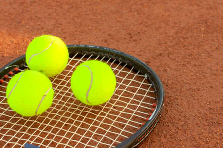 tennis clay: Tennis ball and racquet on a tennis clay court Stock Photo