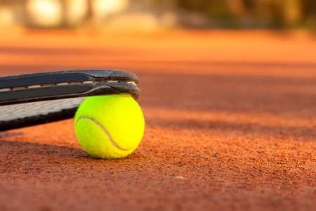 Tennis ball and racquet on a tennis clay court Standard-Bild